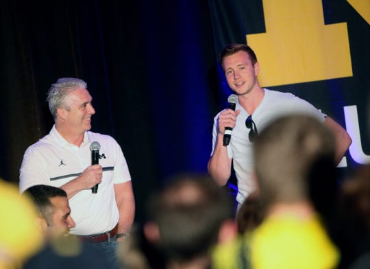 Matt Shepard talks with former U-M guard Spike Albrecht during a pep rally in San Antonio, March 30, 2018.