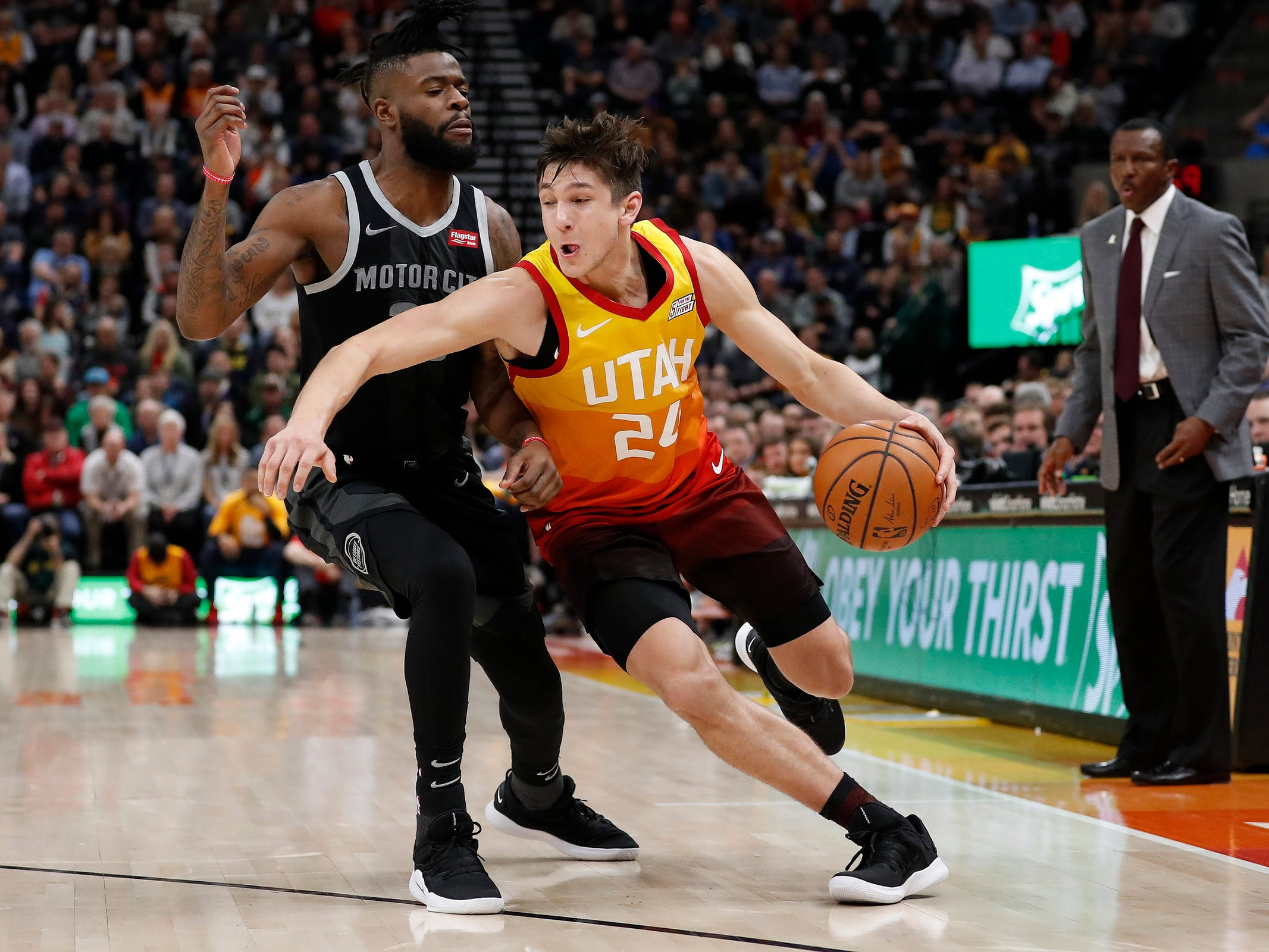 Jazz guard Grayson Allen looks to dribble past Pistons guard Reggie Bullock in the fourth quarter of the 100-94 loss to the Jazz on Monday, Jan. 14, 2019, in Salt Lake City.