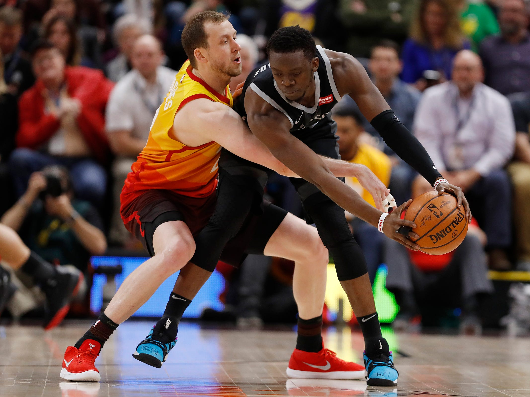 Jazz forward Joe Ingles and Pistons guard Reggie Jackson battle in the third quarter of the 100-94 loss to the Jazz on Monday, Jan. 14, 2019, in Salt Lake City.