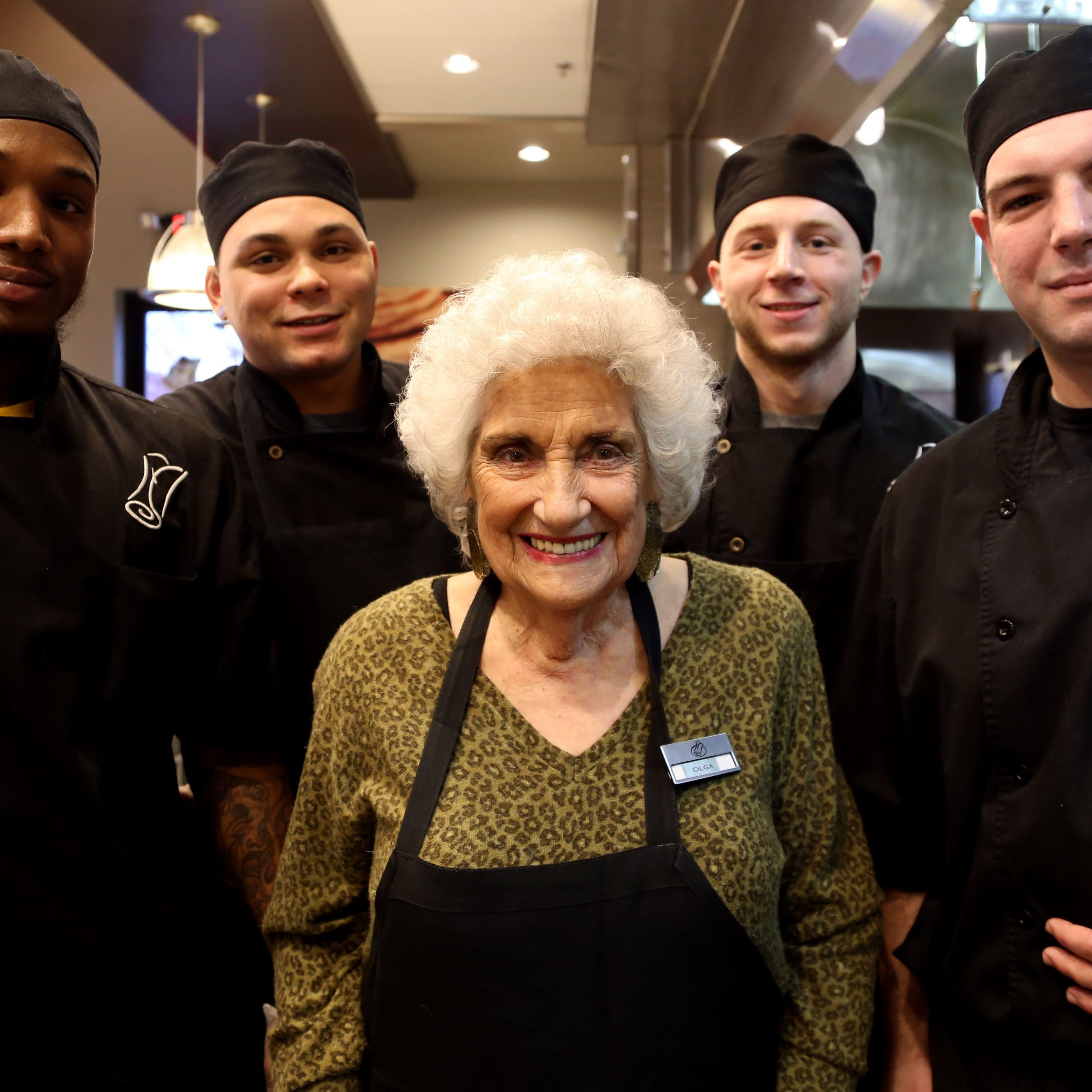 Olga Loizon, center,  is the founder of the restaurant chain Olga's. Here she poses with, left to right: culinary specialists William Claybrooks, Davon Weatherholt, Tyler Canyock, and Mattew Maule on Thurs., December 5, 2013.