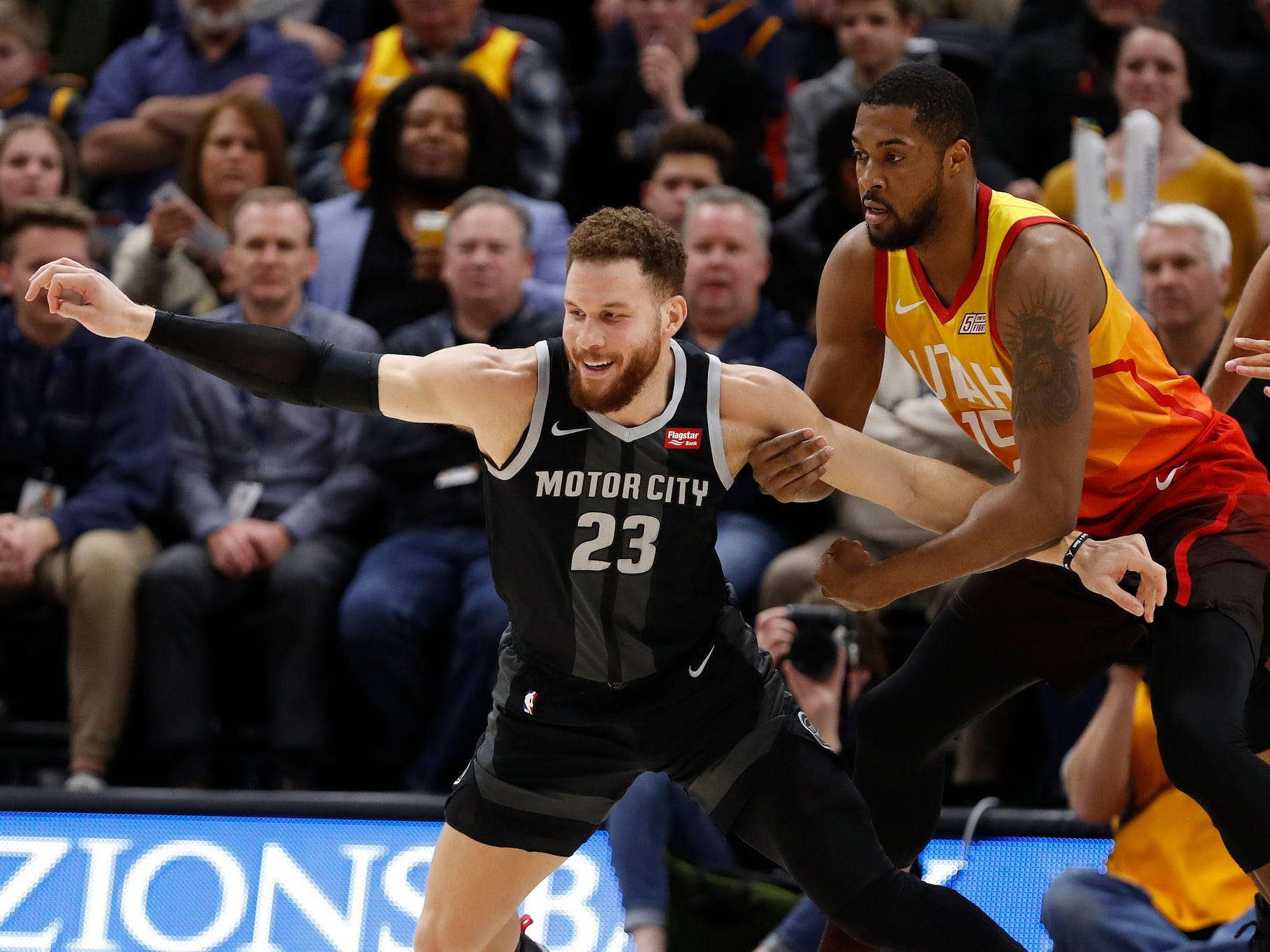 Pistons forward Blake Griffin is held back from a loose ball by Jazz forward Derrick Favors in the third quarter of the 100-94 loss to the Jazz on Monday, Jan. 14, 2019, in Salt Lake City.