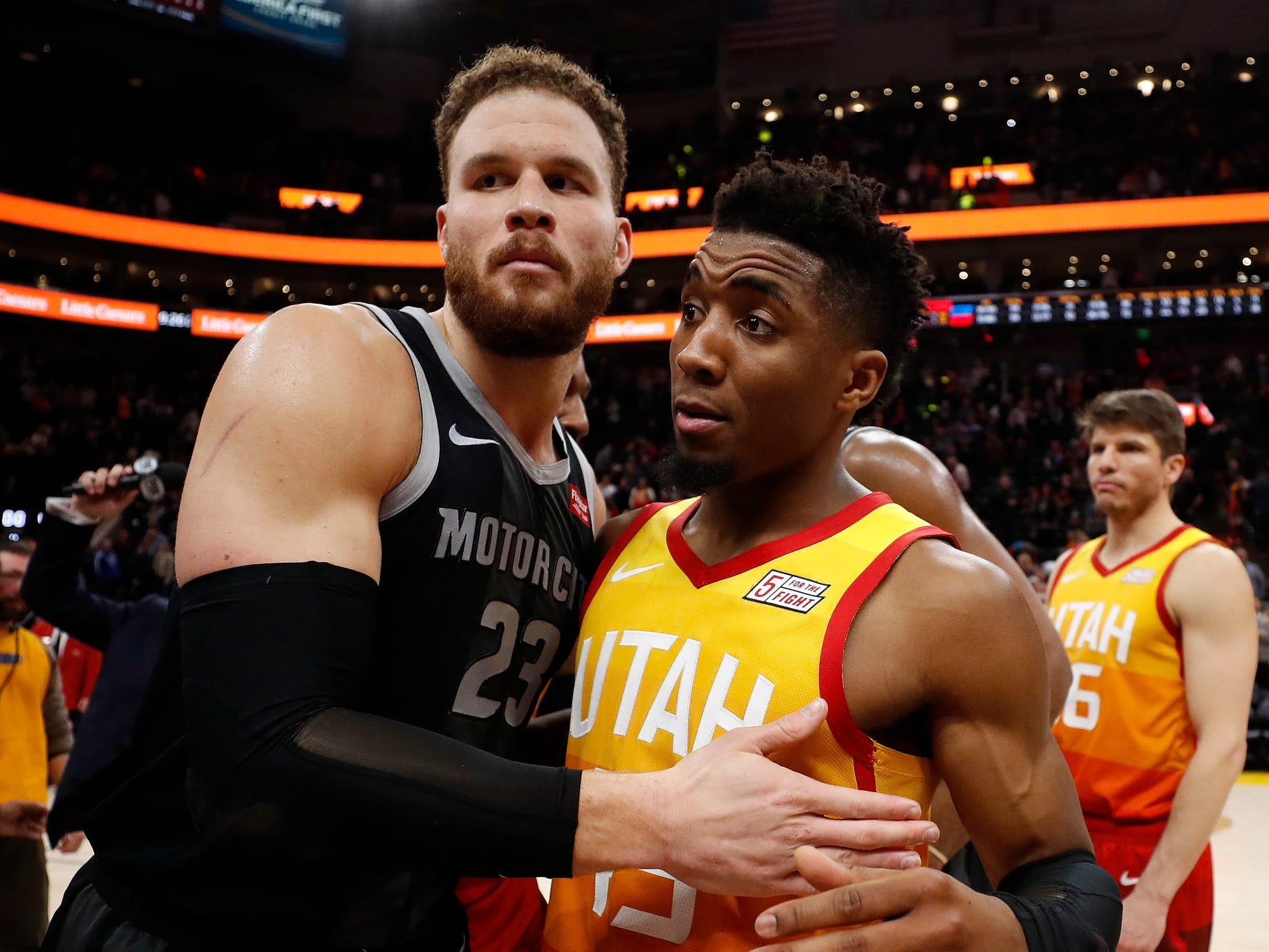 Pistons forward Blake Griffin and Utah Jazz guard Donovan Mitchell get together after the Pistons' 100-94 loss to the Jazz on Monday, Jan. 14, 2019, in Salt Lake City.