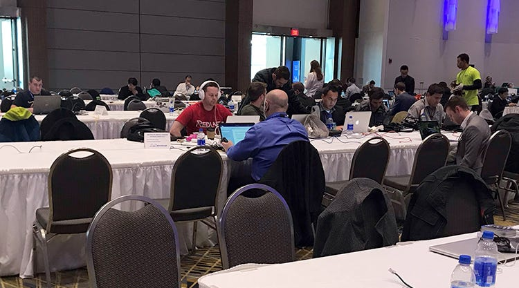 North American International Auto Show attendees inside the media center Monday, Jan. 14, 2019, at Cobo Center in Detroit.