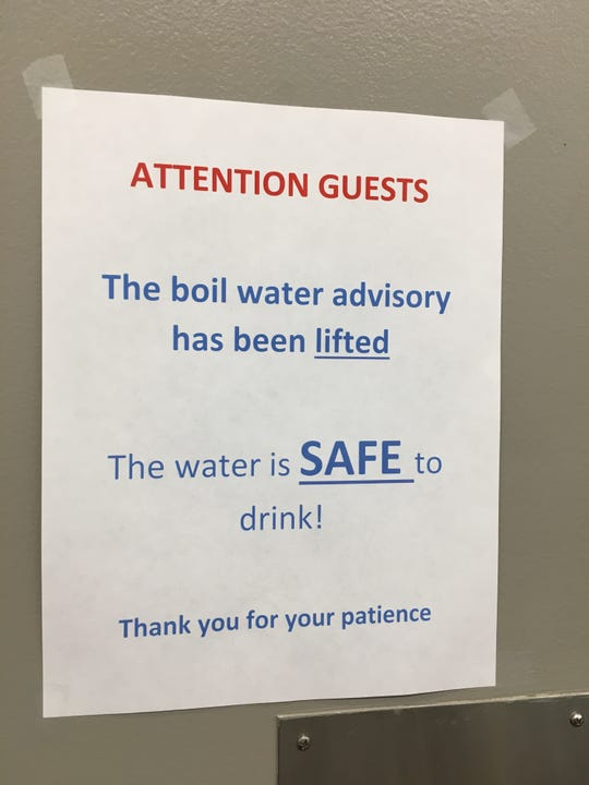 Signs above the water fountains at Cobo Center in Detroit alert attendees that the water is safe.
