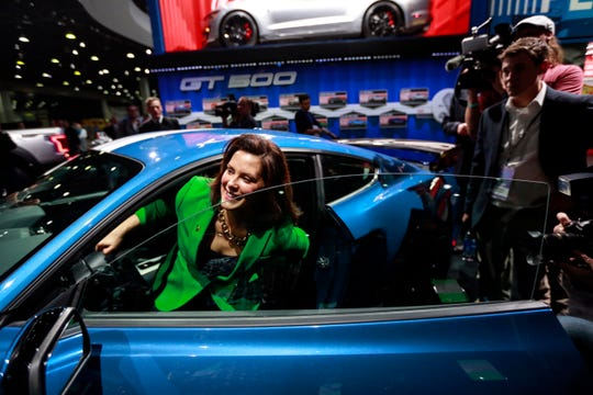 Michigan Governor Gretchen Whitmer steps out of the 2020 Ford Mustang GT500 during her tour of the 2019 North American International Auto Show held at Cobo Center in downtown Detroit on Tuesday, Jan. 15, 2019