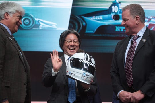 (From left) IndyCar CEO Mark Miles, NTT executive vice president Tsunehisa Okuno and IndyCar president Jay Frye pose for a photo after the announcement of the NTT IndyCar series during the North American International Auto Show at Cobo Center on Tuesday, Jan. 15, 2019.