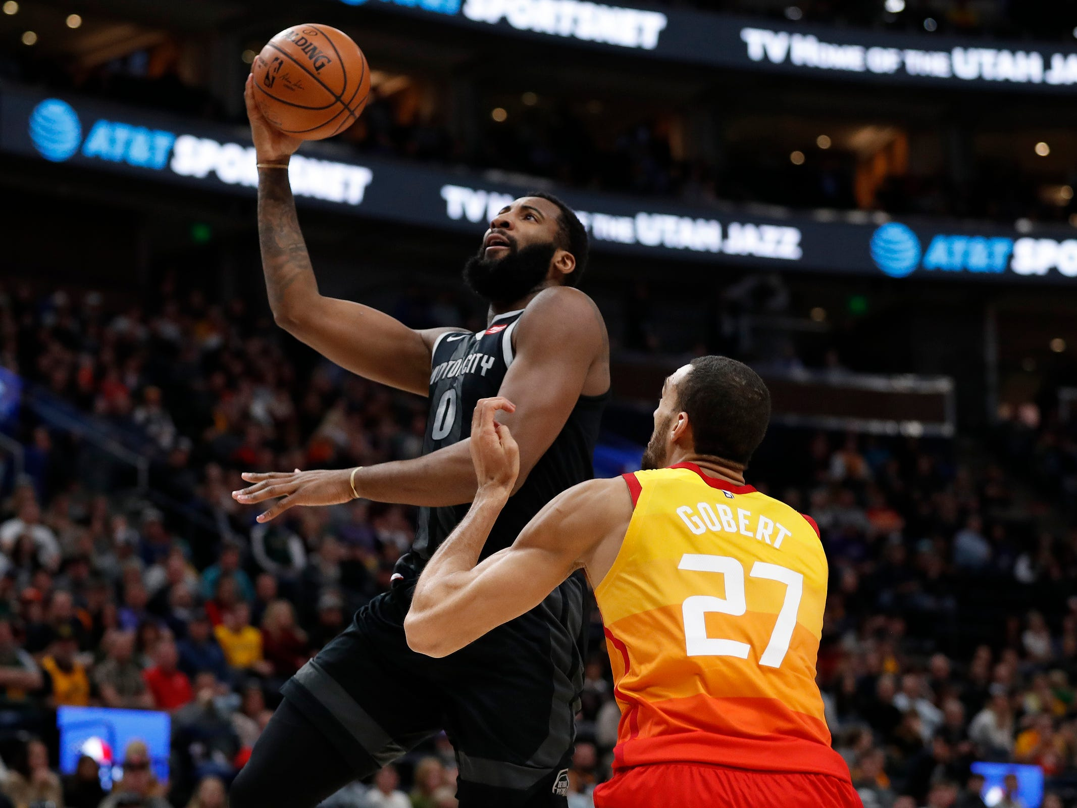 Detroit Pistons center Andre Drummond drives to the hoop against Utah Jazz center Rudy Gobert in the first quarter Monday, Jan. 14, 2019, in Salt Lake City.