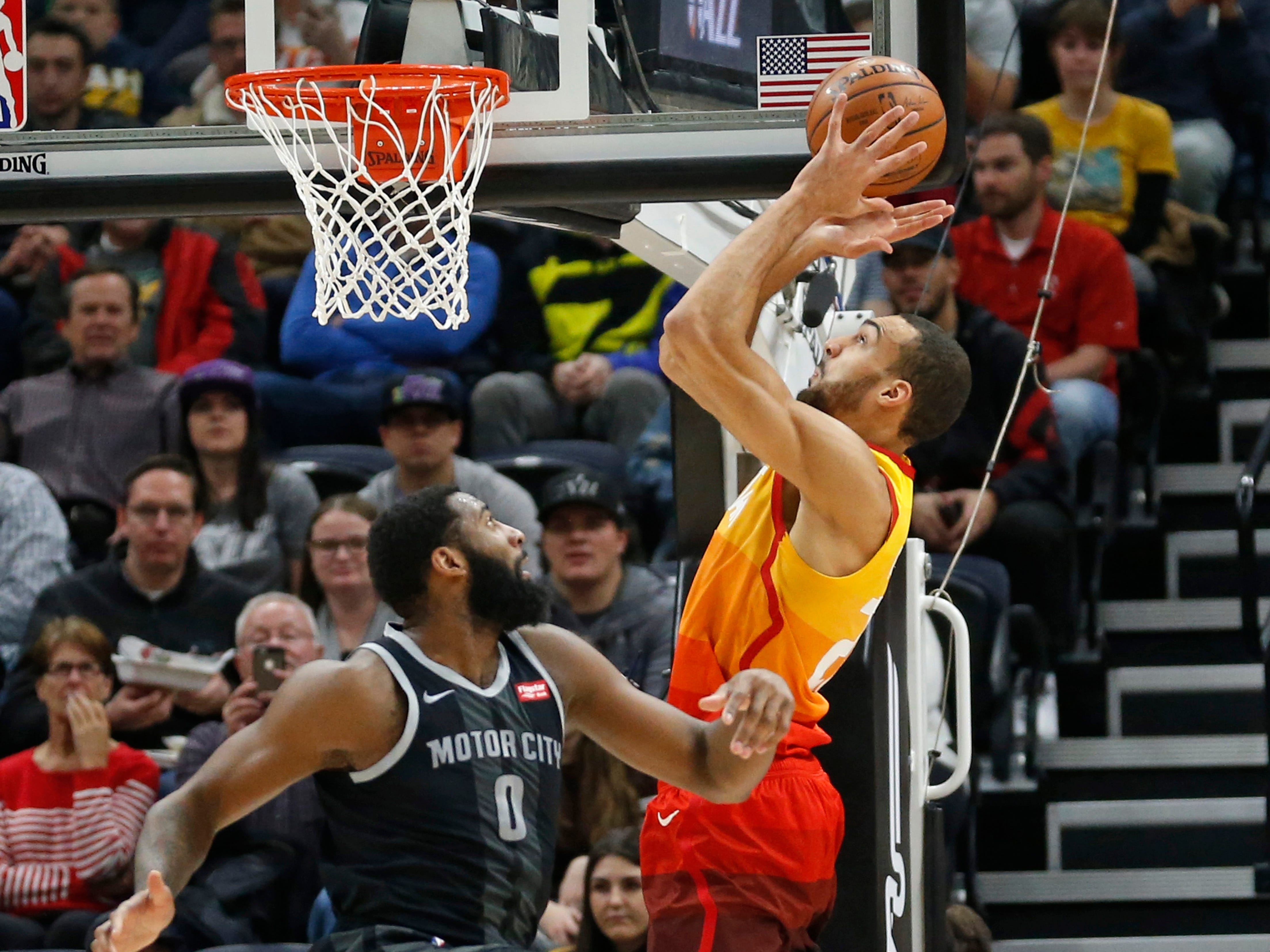 Utah Jazz' Rudy Gobert reaches for a pass against Detroit Pistons' Andre Drummond in the first half Monday, Jan. 14, 2019, in Salt Lake City.