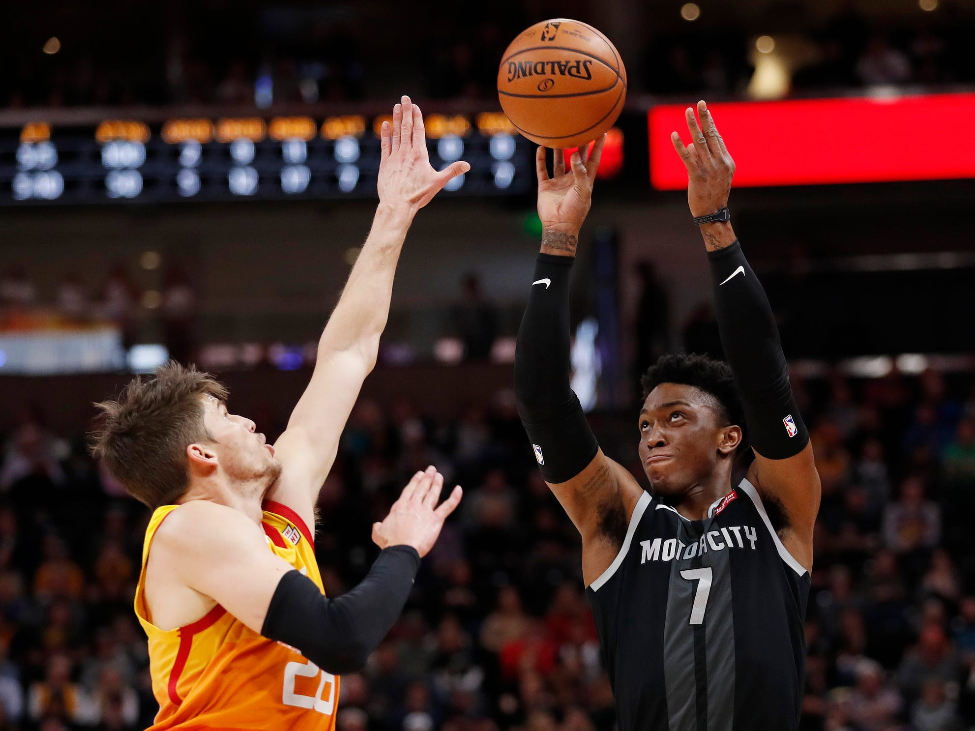 Pistons forward Stanley Johnson shoots against Jazz guard Kyle Korver in the second quarter of the 100-94 loss to the Jazz on Monday, Jan. 14, 2019, in Salt Lake City.