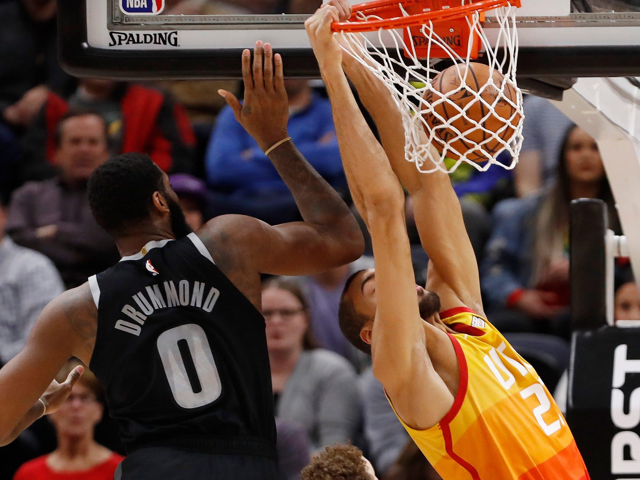 Utah Jazz center Rudy Gobert dunks against Detroit Pistons center Andre Drummond in the first half Monday, Jan. 14, 2019, in Salt Lake City.