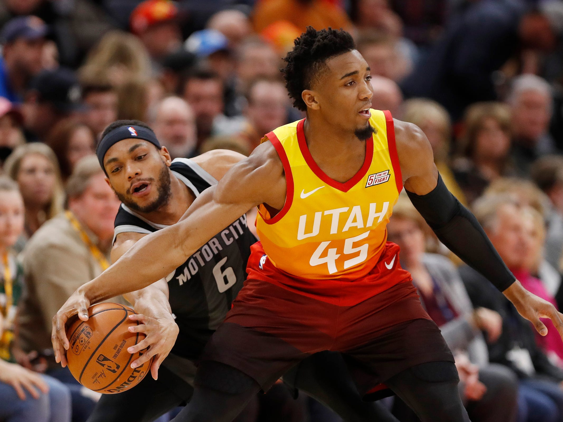 Detroit Pistons guard Bruce Brown looks to steal the ball from Utah Jazz guard Donovan Mitchell in the first half Monday, Jan. 14, 2019, in Salt Lake City.