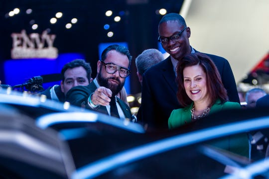 GAC Executive Design Director Pontus Fontaeus, speaks with Michigan Governor Gretchen Whitmer and  Liet. Gov. Garlin Gilchrist as they tour the GAC Motor exhibit during the 2019 North American International Auto Show held at Cobo Center in downtown Detroit on Tuesday, Jan. 15, 2019