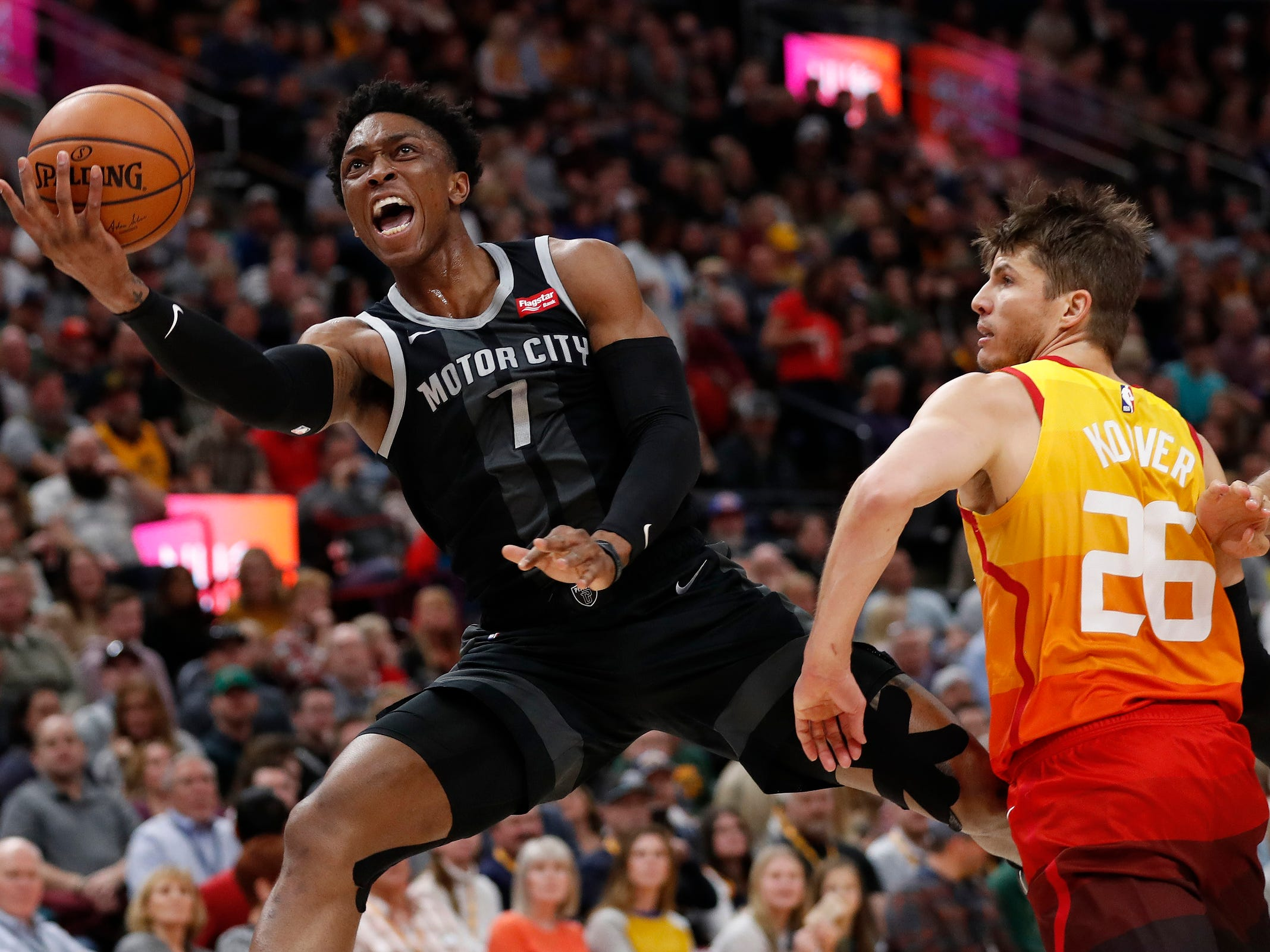 Pistons guard Reggie Jackson drives to the hoop against Jazz guard Kyle Korver in the second quarter of the 100-94 loss to the Jazz on Monday, Jan. 14, 2019, in Salt Lake City.