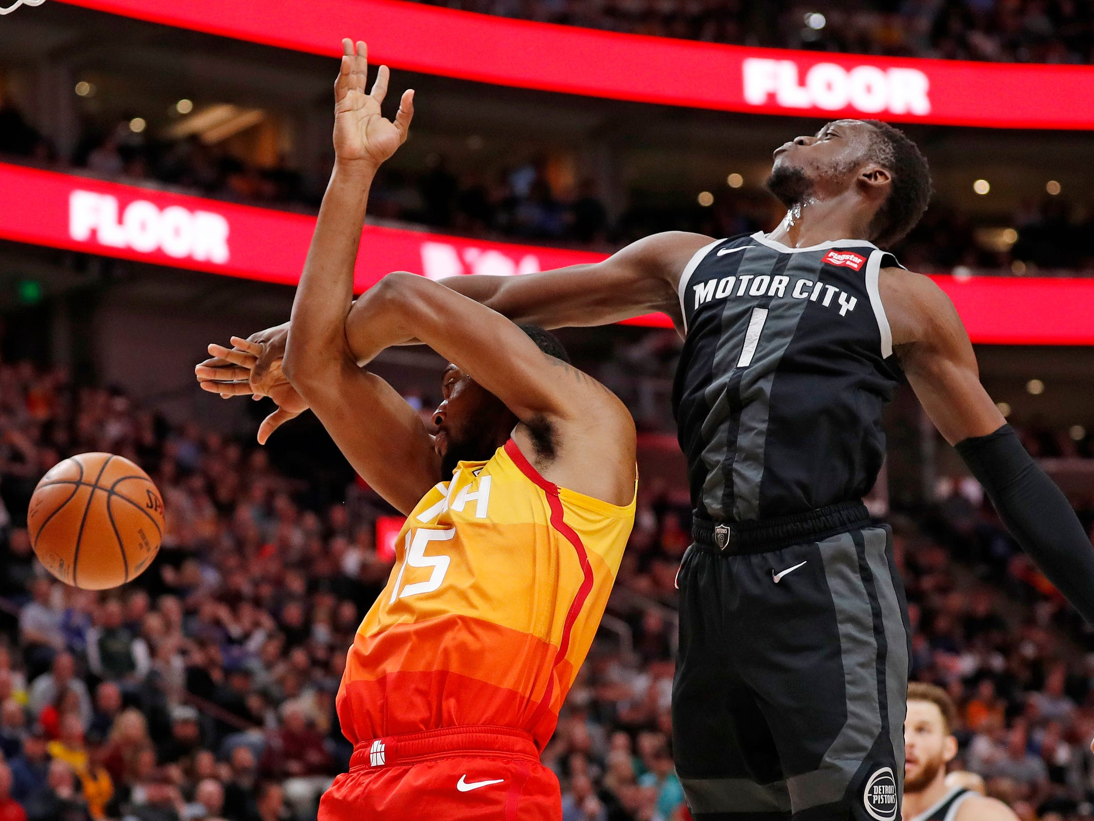 Jazz forward Derrick Favors and Pistons guard Reggie Jackson battle in the third quarter of the 100-94 loss to the Jazz on Monday, Jan. 14, 2019, in Salt Lake City.