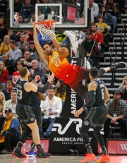 Jazz center Rudy Gobert dunks against the Pistons in the first half Monday in Salt Lake City.