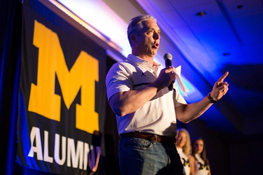 Matt Shepard speaks during a U-M pep rally in San Antonio, March 30, 2018.