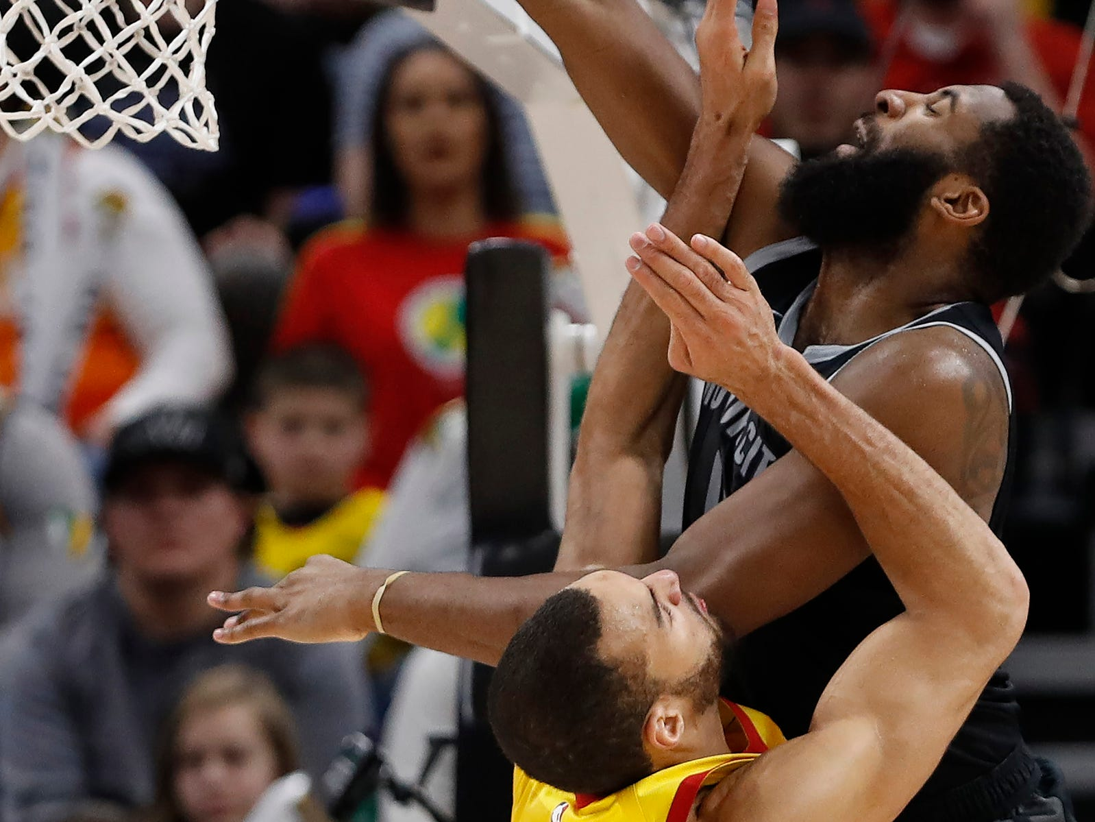 Jazz center Rudy Gobert guards Pistons center Andre Drummond in the fourth quarter of the 100-94 loss to the Jazz on Monday, Jan. 14, 2019, in Salt Lake City.