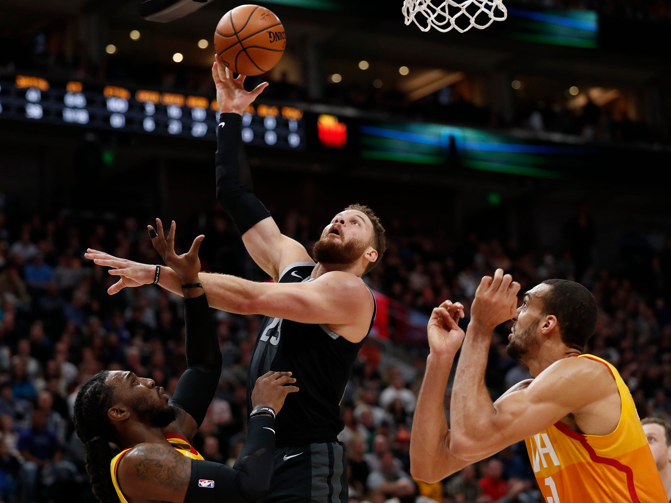 Pistons forward Blake Griffin shoots against Jazz forward Jae Crowder and center Rudy Gobert in the second quarter of the 100-94 loss to the Jazz on Monday, Jan. 14, 2019, in Salt Lake City.