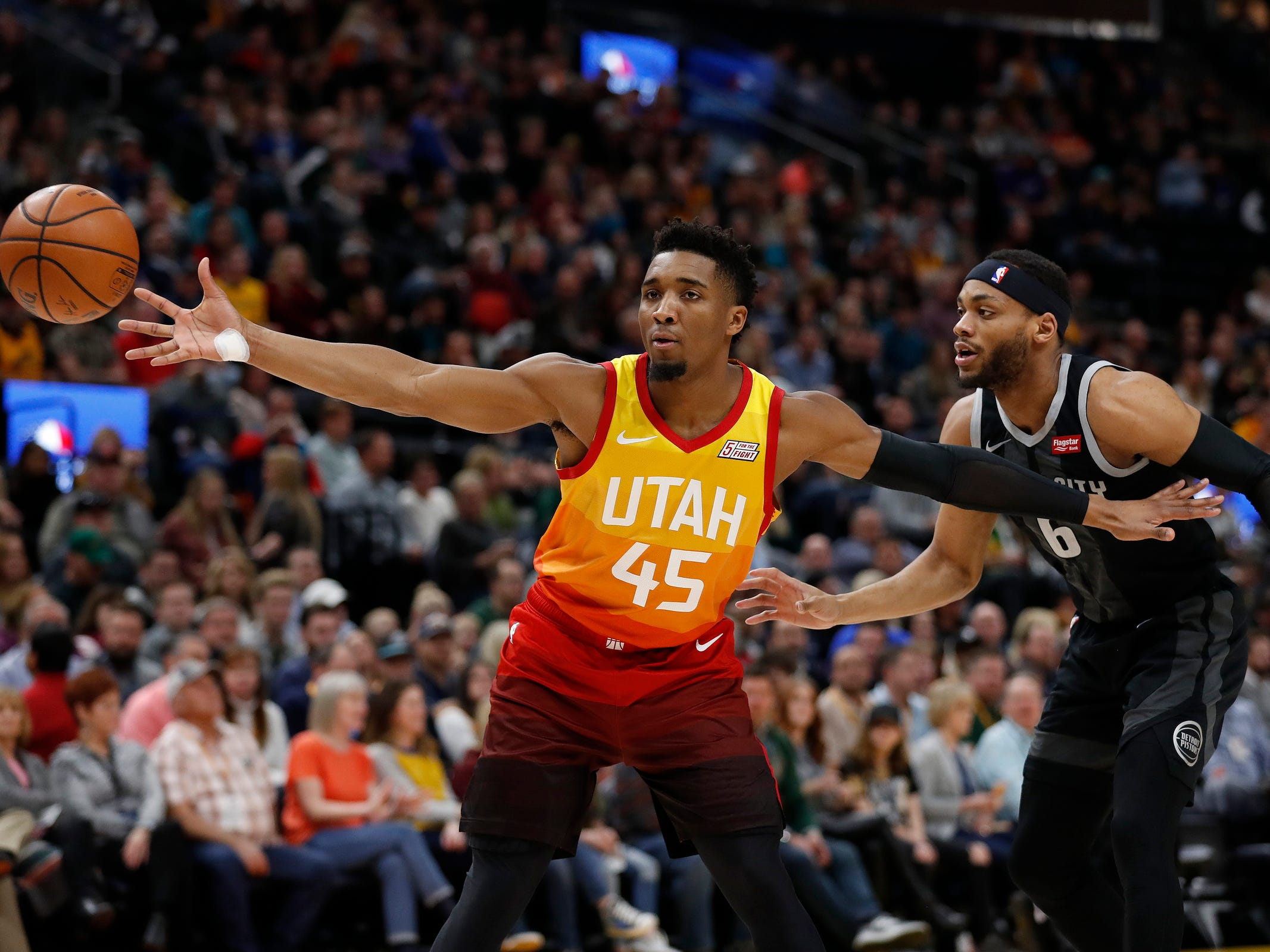 Utah Jazz guard Donovan Mitchell receives a pass against Detroit Pistons guard Bruce Brown in the first quarter Monday, Jan. 14, 2019, in Salt Lake City.