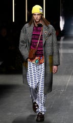 A model wears a creation as part of the Versace men's Fall-Winter 2019-20 collection, that was presented in Milan, Italy, Saturday, Jan.12, 2019.