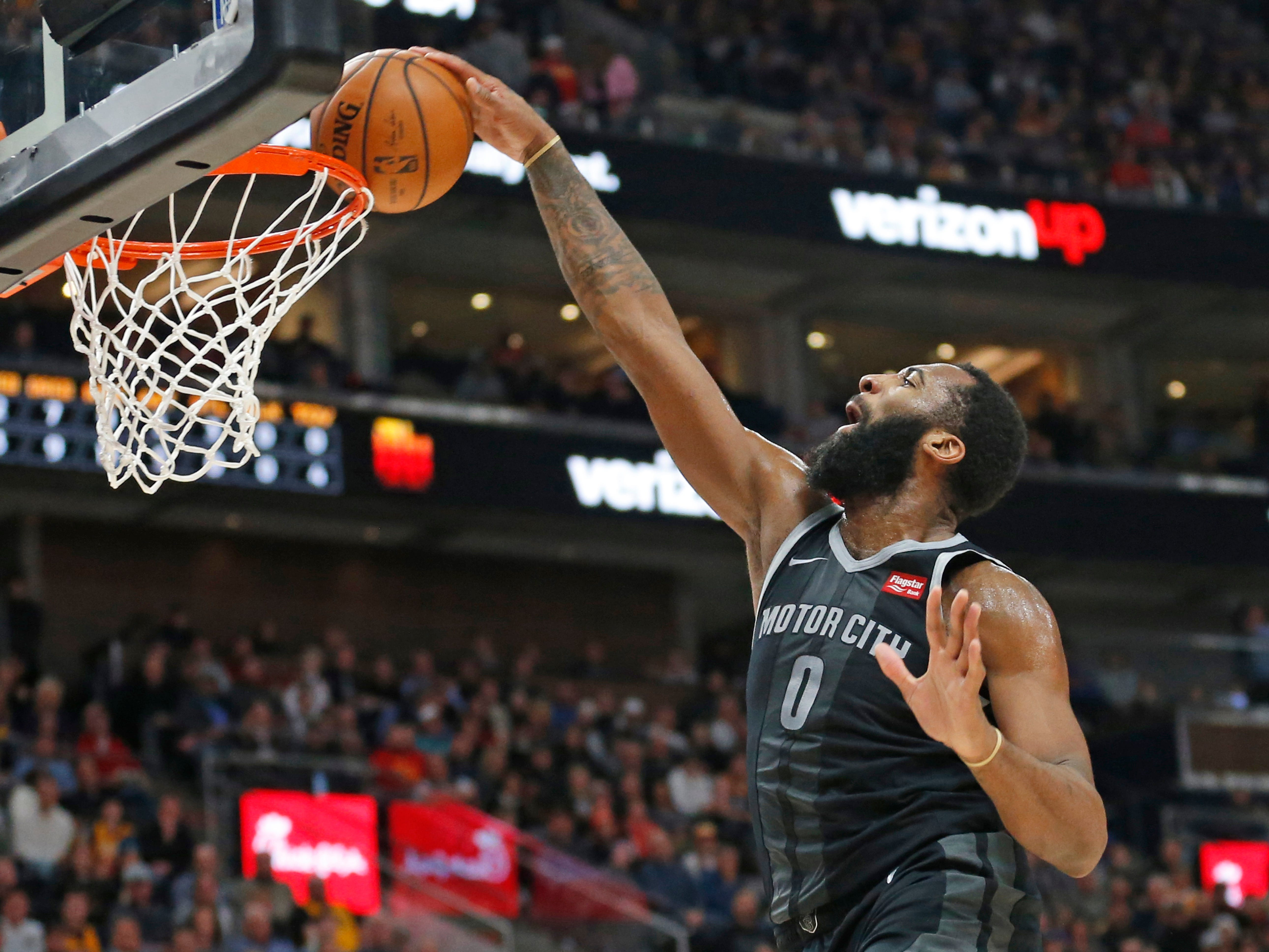Detroit Pistons center Andre Drummond (0) dunks against the Utah Jazz during the first half.