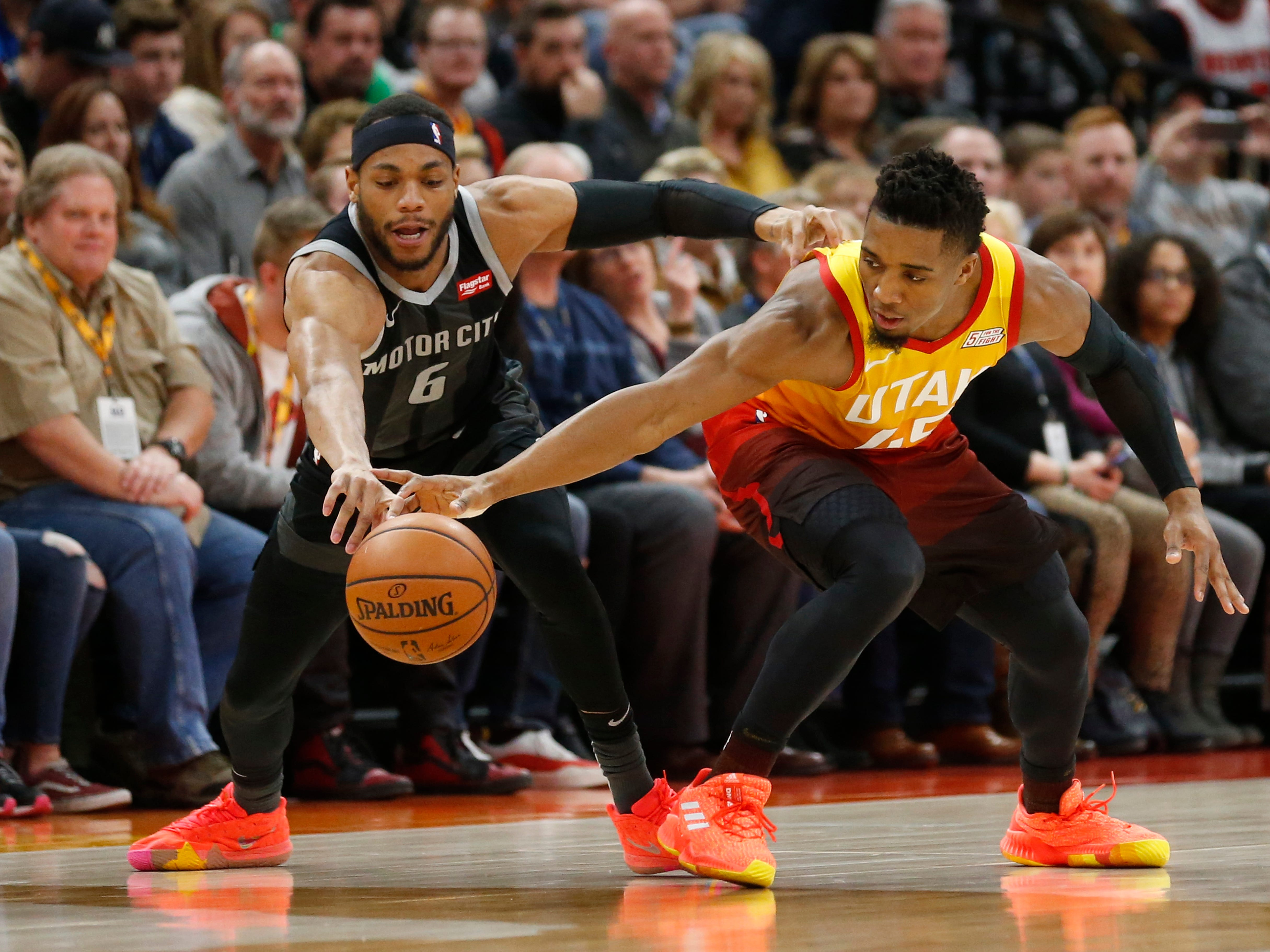 Detroit Pistons guard Bruce Brown, left, attempts a steal from Utah Jazz guard Donovan Mitchell (45) during the first half of an NBA basketball game Monday, Jan. 14, 2019, in Salt Lake City. (AP Photo/Rick Bowmer)