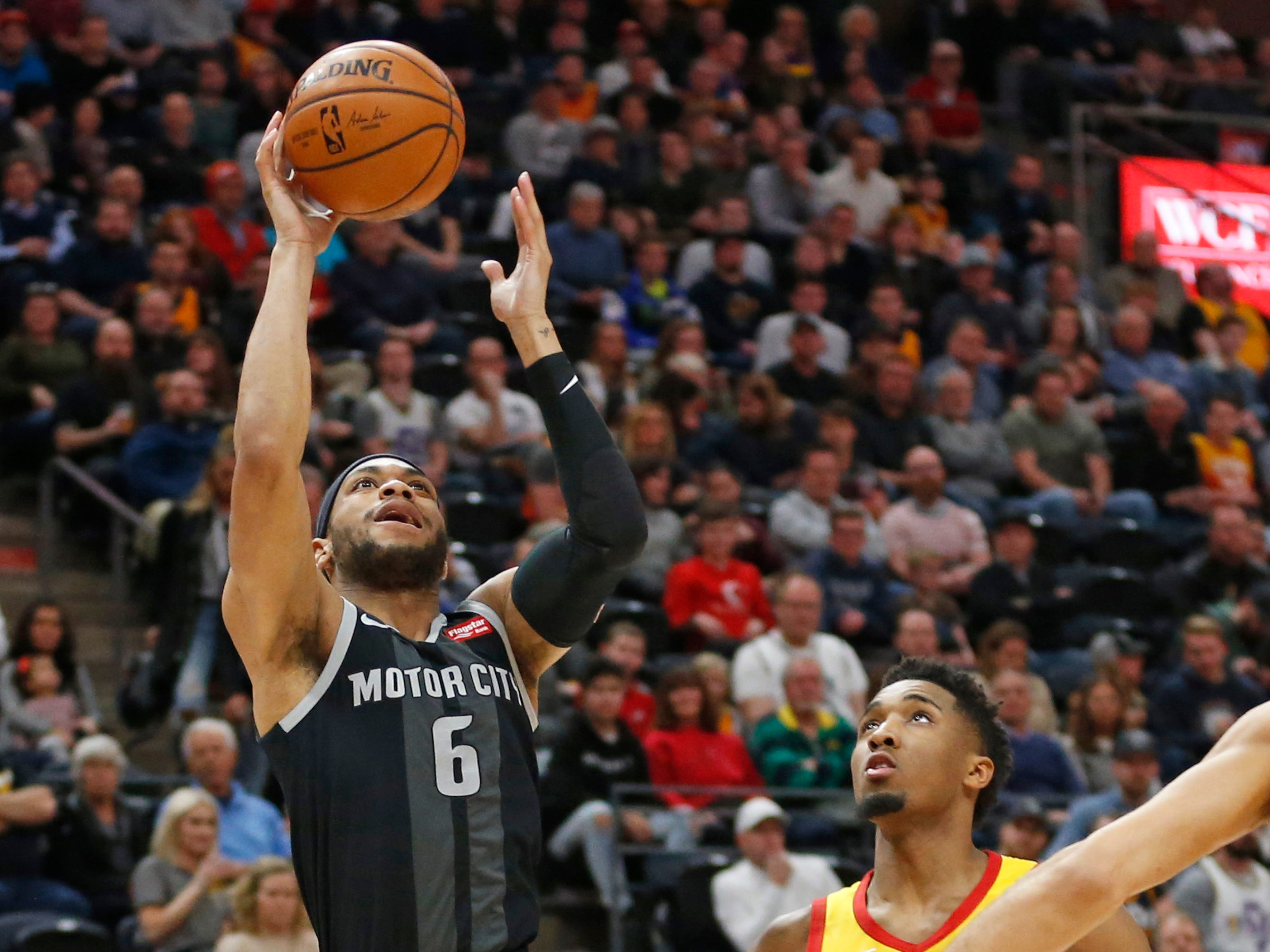 Detroit Pistons guard Bruce Brown (6) goes to the basket as Utah Jazz guard Donovan Mitchell (45) looks on during the first half.