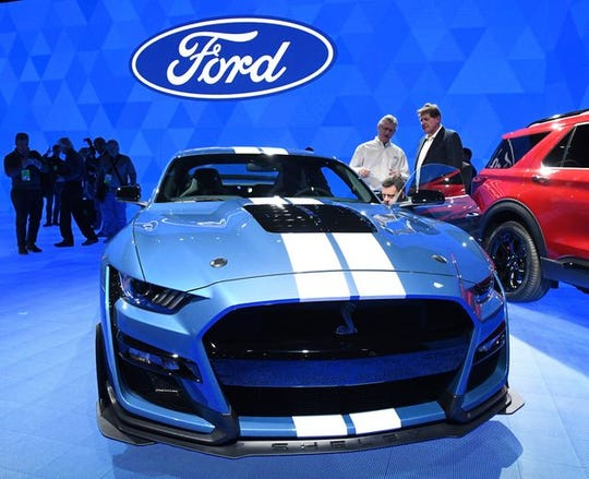 Members of the media look over the Mustang Shelby GT500 at the North American International Auto Show media preview day at Cobo Center in Detroit on Monday.