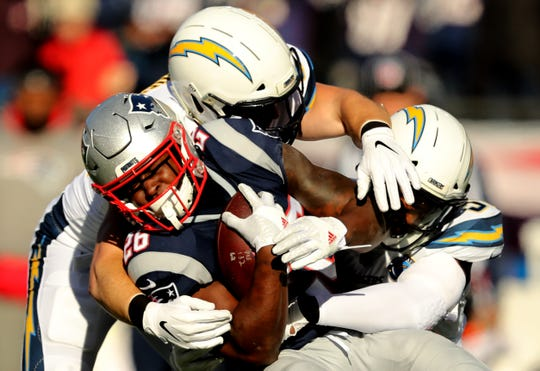 Sony Michel, left, scored three touchdowns and rushed for 129 yards against the Chargers.