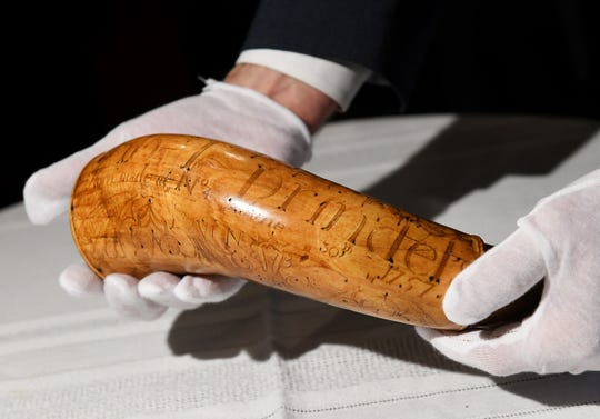 Part of the verse, name and date carved into the powder horn can be seen.  The  artifact was stolen from the Dearborn Historical Museum in 1952 and was tracked down by Dearborn police  and the FBI Art Crime Team.