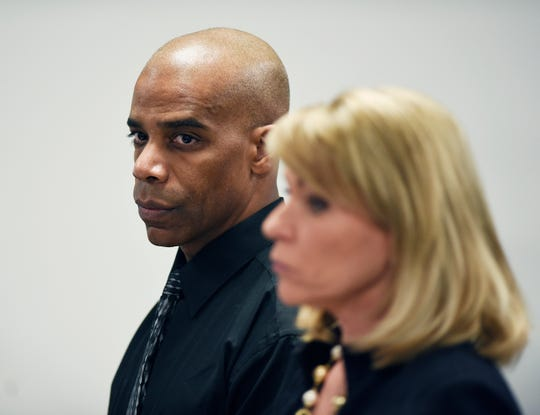Detroit Police Cpl. Dewayne Jones stands with his attorney Pamella Szydlak as they listens to Judge Cylenthia LaToye Miller during his hearing.