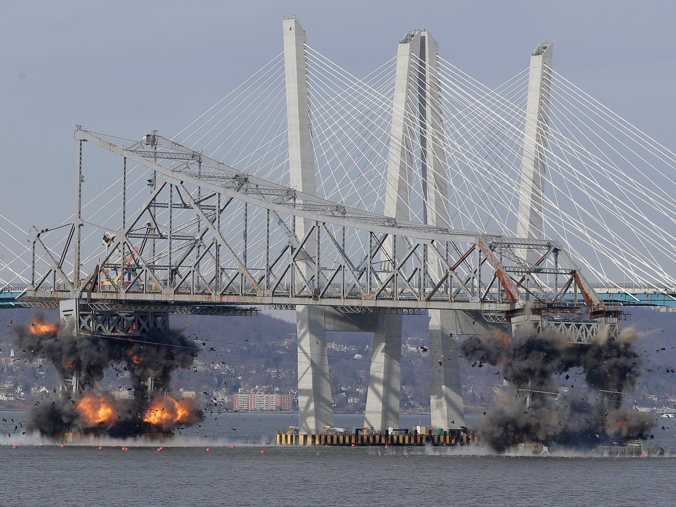 A section of the old Tappan Zee Bridge is brought down with explosives in this view from Tarrytown, N.Y., Tuesday, January 15, 2019.