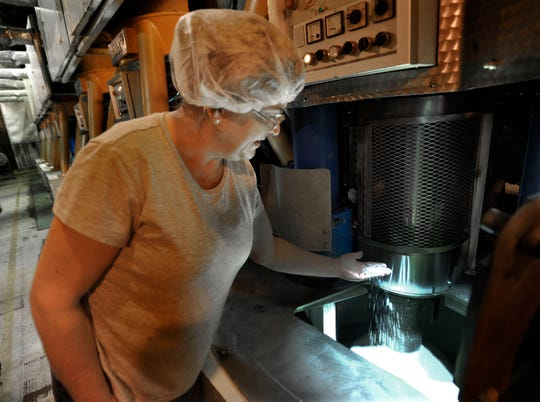 Connie Jacobs supervises a bank of centrifuges that spin molasses into sugar at the Pioneer Sugar Plant in Bay City in Michigan's Thumb.