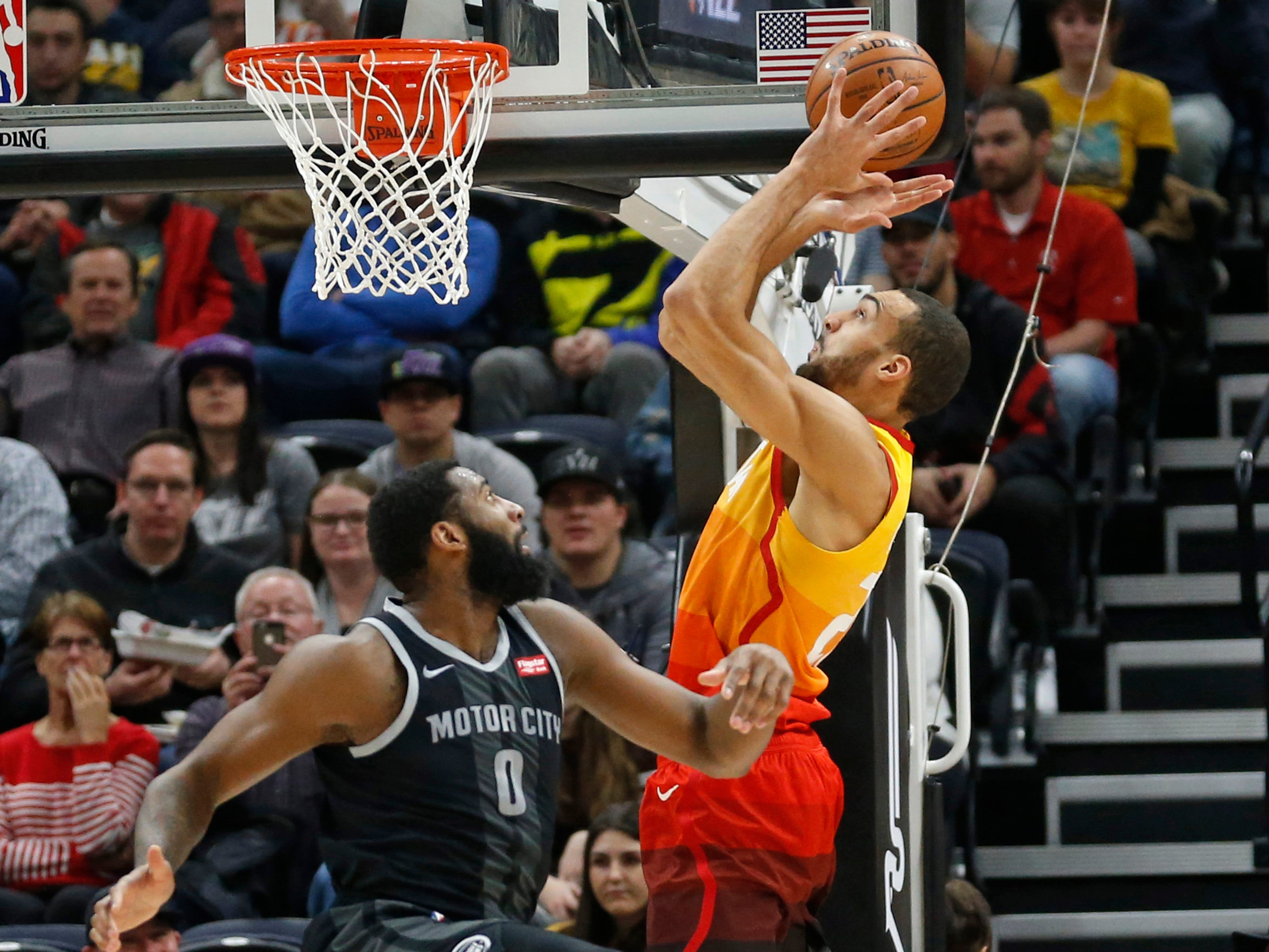 Utah Jazz center Rudy Gobert, right, reaches for a pass as Detroit Pistons forward Henry Ellenson (8) looks on during the first half.