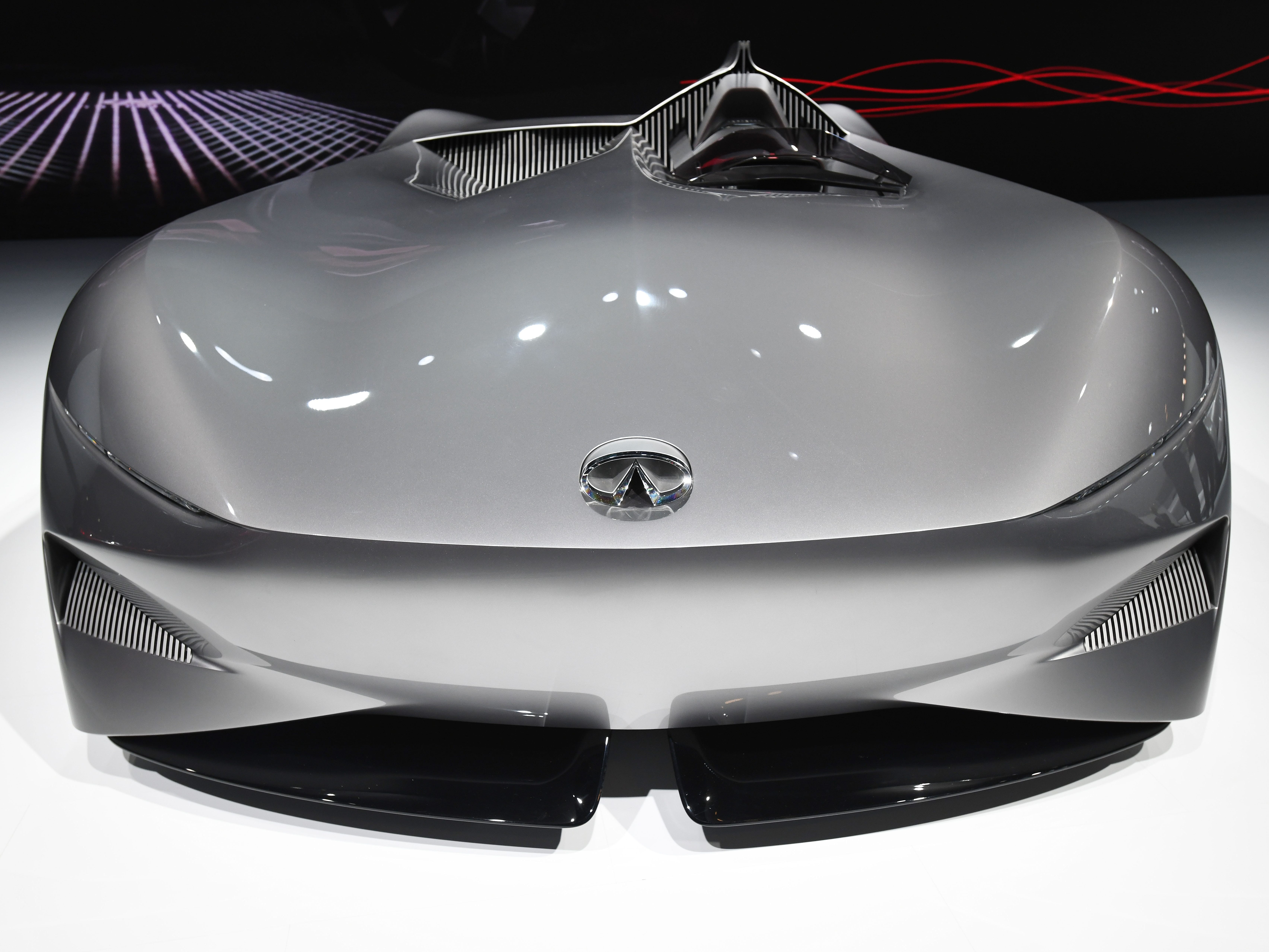 The Infiniti Prototype 10 Concept has a  single-seat cockpit with a low seating position, with only the driver's head peeking above the broad front end.