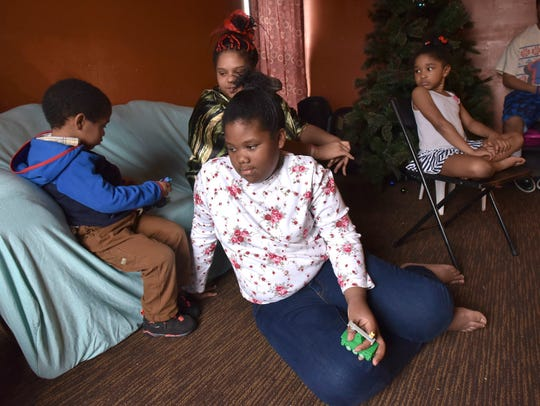 Ariel Lawson, 11, center, received special education services at Houston public schools from 2015-17. But when her family moved to Flint in 2017, the district told Ariel's family she did not meet the criteria for the services.