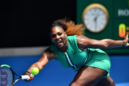 Serena Williams of the U.S. hits a return against Germany's Tatjana Maria during their first-round singles match on Day 2 of the Australian Open tennis tournament. Williams defeated Maria, 6-0, 6-2.