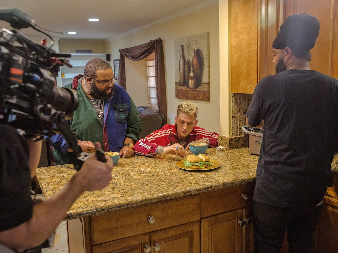 "Cliff Skighwalker and celebrity guest rapper Machine Gun Kelly check out some cuisine on an episode of ""Instachef"" filmed in New Orleans. Skighwalker hosts the web series which highlights cooks who sell their food primarily using Instagram."