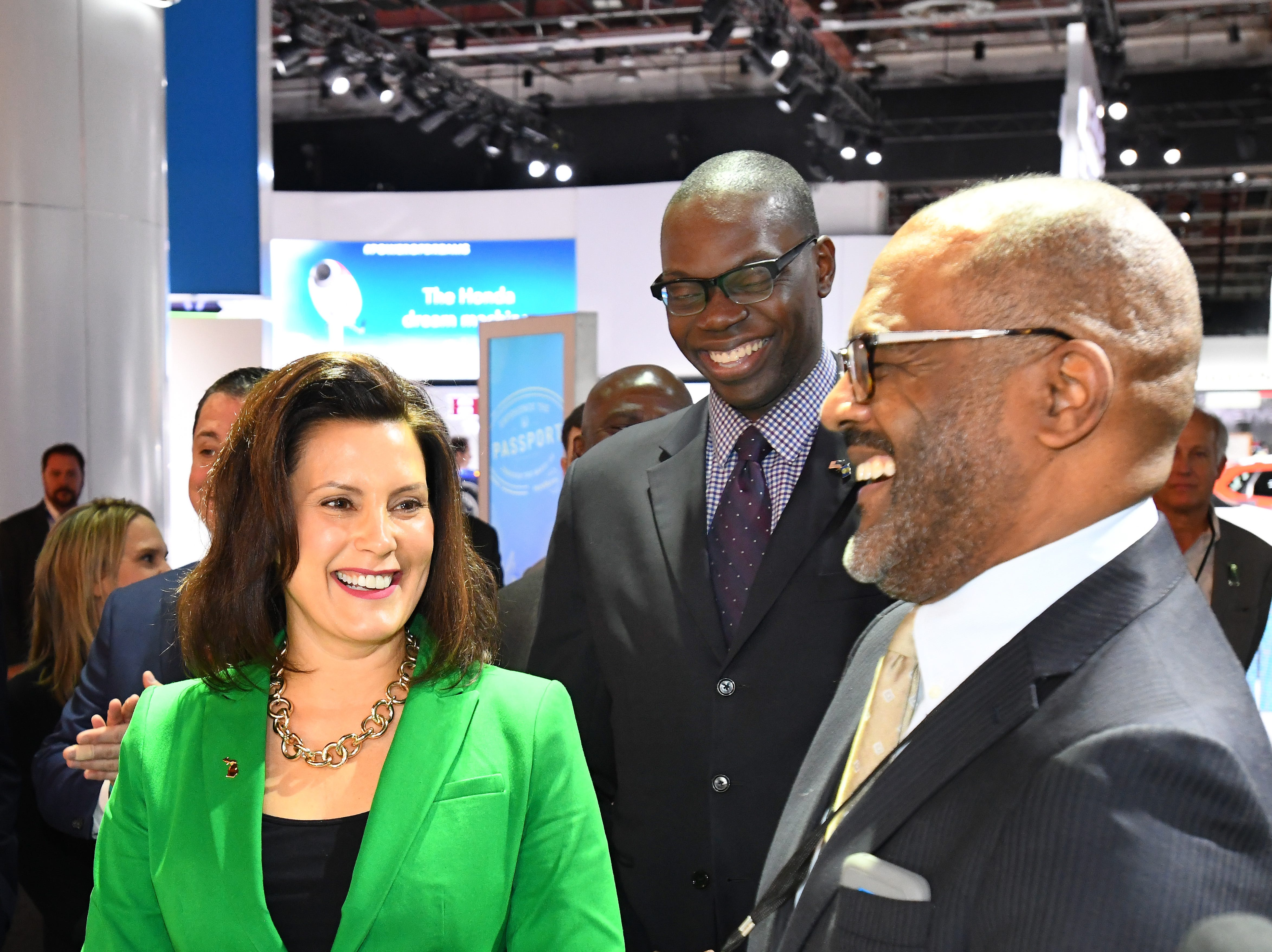 Michigan Governor Gretchen Whitmer and Lieutenant Governor Garlin Gilchrist is showed around the General Motors display by North America Manufacturing Vice President Gerald Johnson.