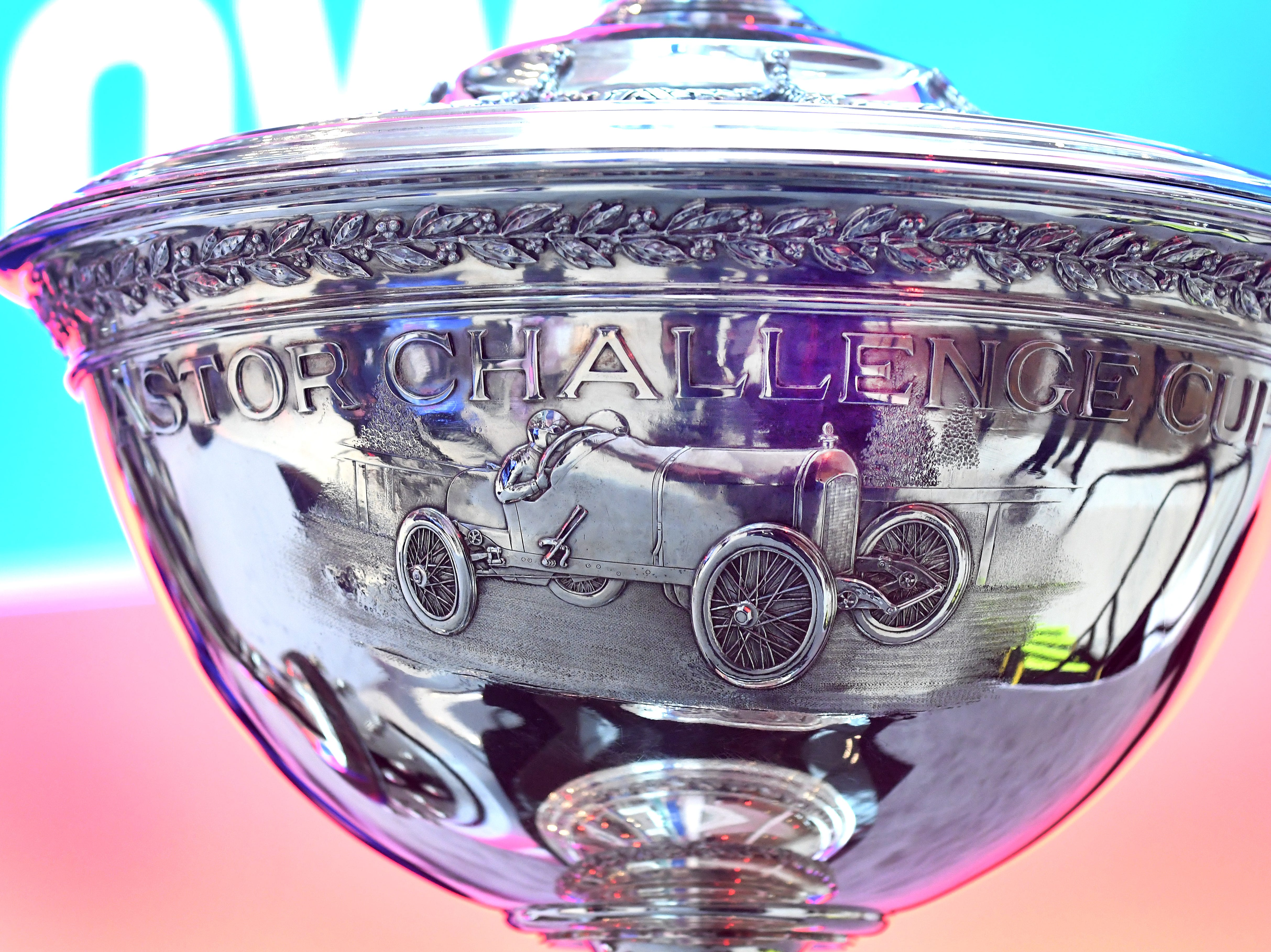 The Astor Challenge Cup, awarded to the IndyCar series winner each year, is displayed Tuesday during a press conference announcing new series sponsor NTT at the auto show.