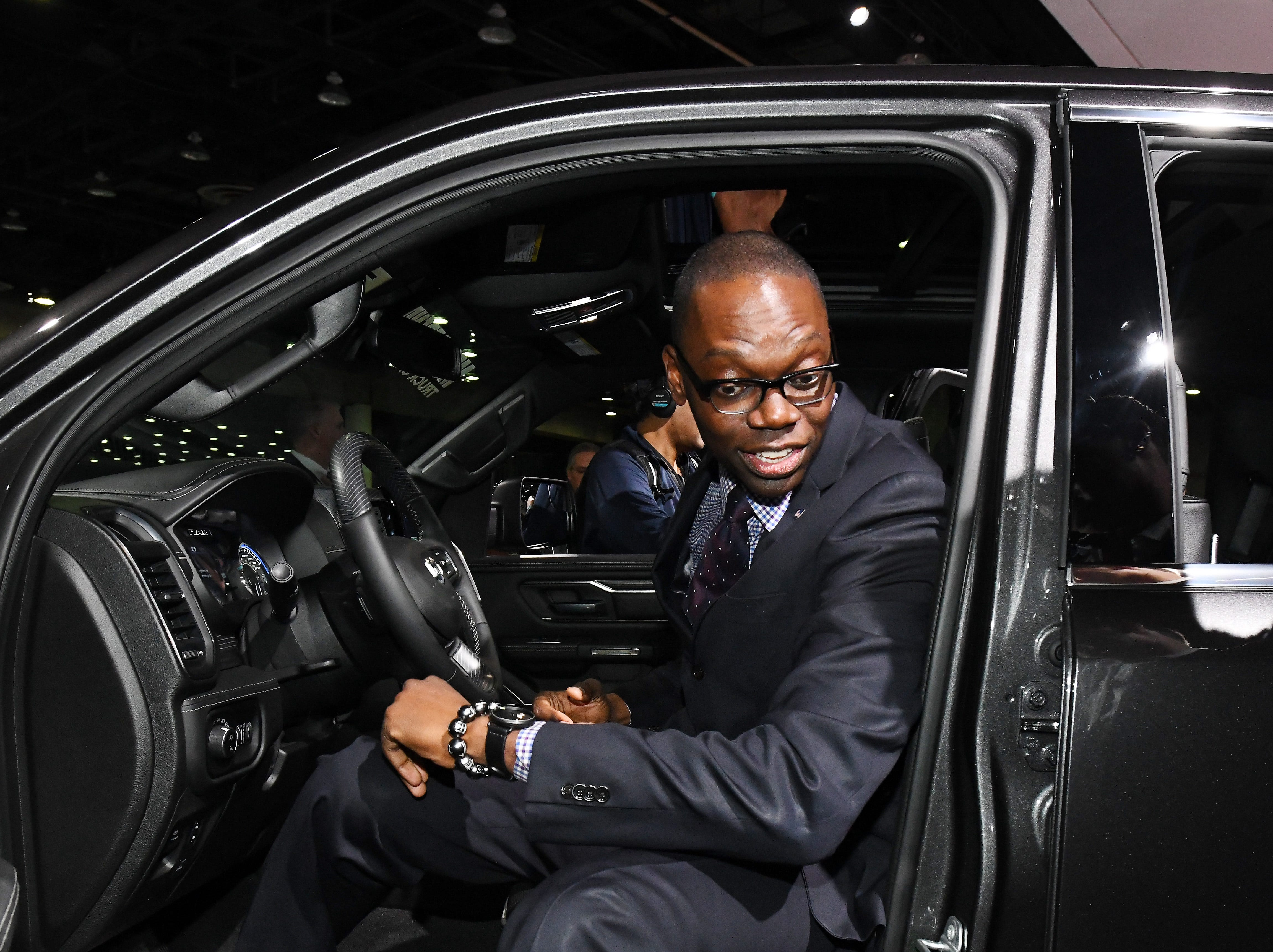 Michigan Lieutenant Governor Garlin Gilchrist looks over a Ram 1500 during a tour of the FCA display at the North American International Auto Show.
