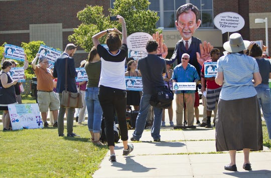 Protesters assemble before the Enbridge Line 5 pipeline public information session at Holt High School on Thursday, July 6, 2017 in Holt, Mich. The report by Dynamic Risk Assessment Systems, Inc. was prepared independently for the state of Michigan.