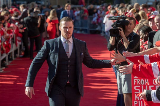"""""""It'd be an absolute honor to finish my career here. Like I've said, this is home,"""" says Red Wings goalie Jimmy Howard, high-fiving fans while taking part in the red carpet welcome at Little Caesars Arena before the season opener against the Columbus Blue Jackets Oct. 4."""