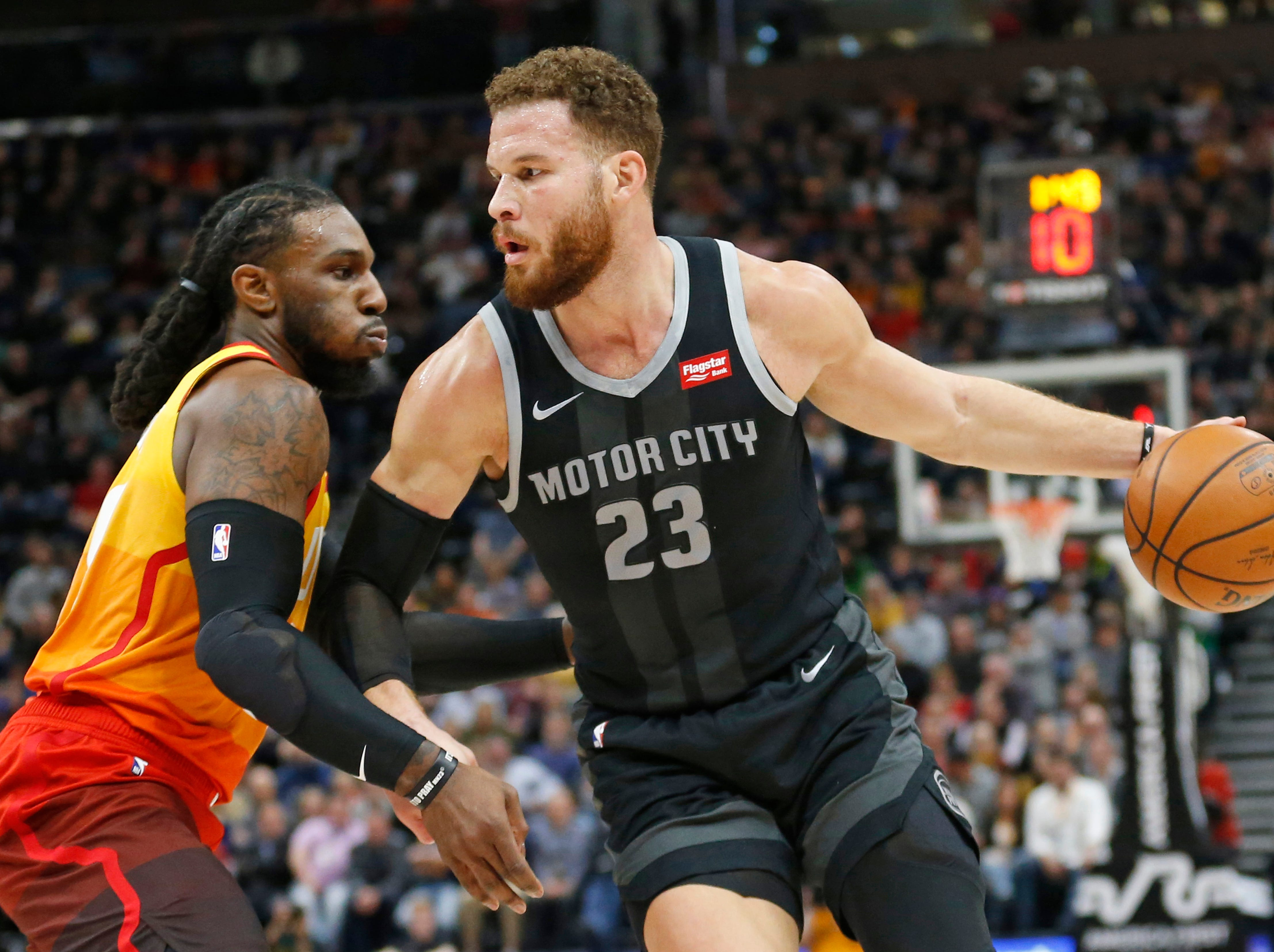 Utah Jazz forward Jae Crowder, left, guards Detroit Pistons forward Blake Griffin (23) during the first half of an NBA basketball game Monday, Jan. 14, 2019, in Salt Lake City. (AP Photo/Rick Bowmer)