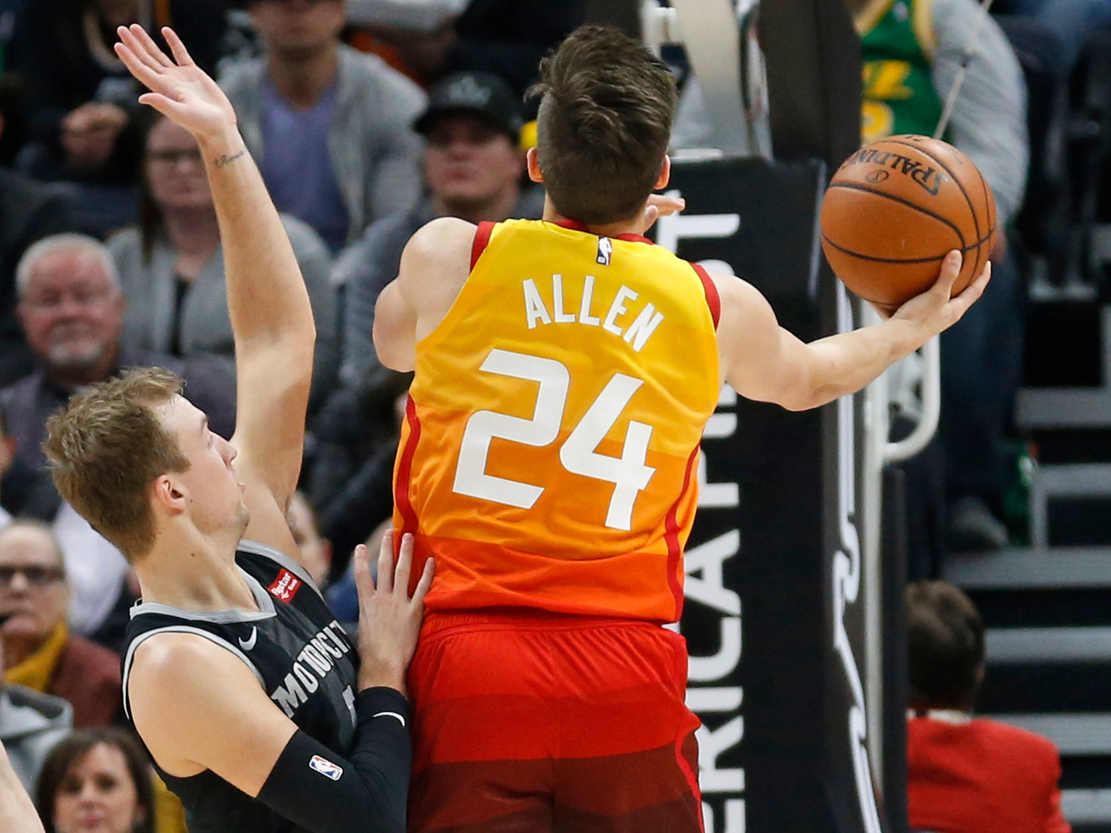 Utah Jazz guard Grayson Allen (24) lays the ball up as Detroit Pistons guard Luke Kennard (5) defends during the first half.