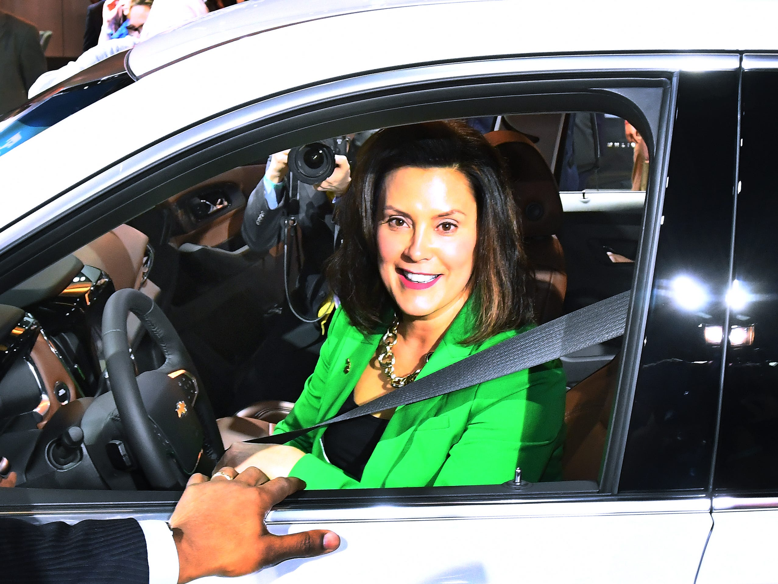 Michigan Governor Gretchen Whitmer gets a feel for the Chevrolet Traverse in the General Motors display during a tour of the North American International Auto Show during media preview days at Cobo Center in Detroit, Michigan on January 14, 2019.