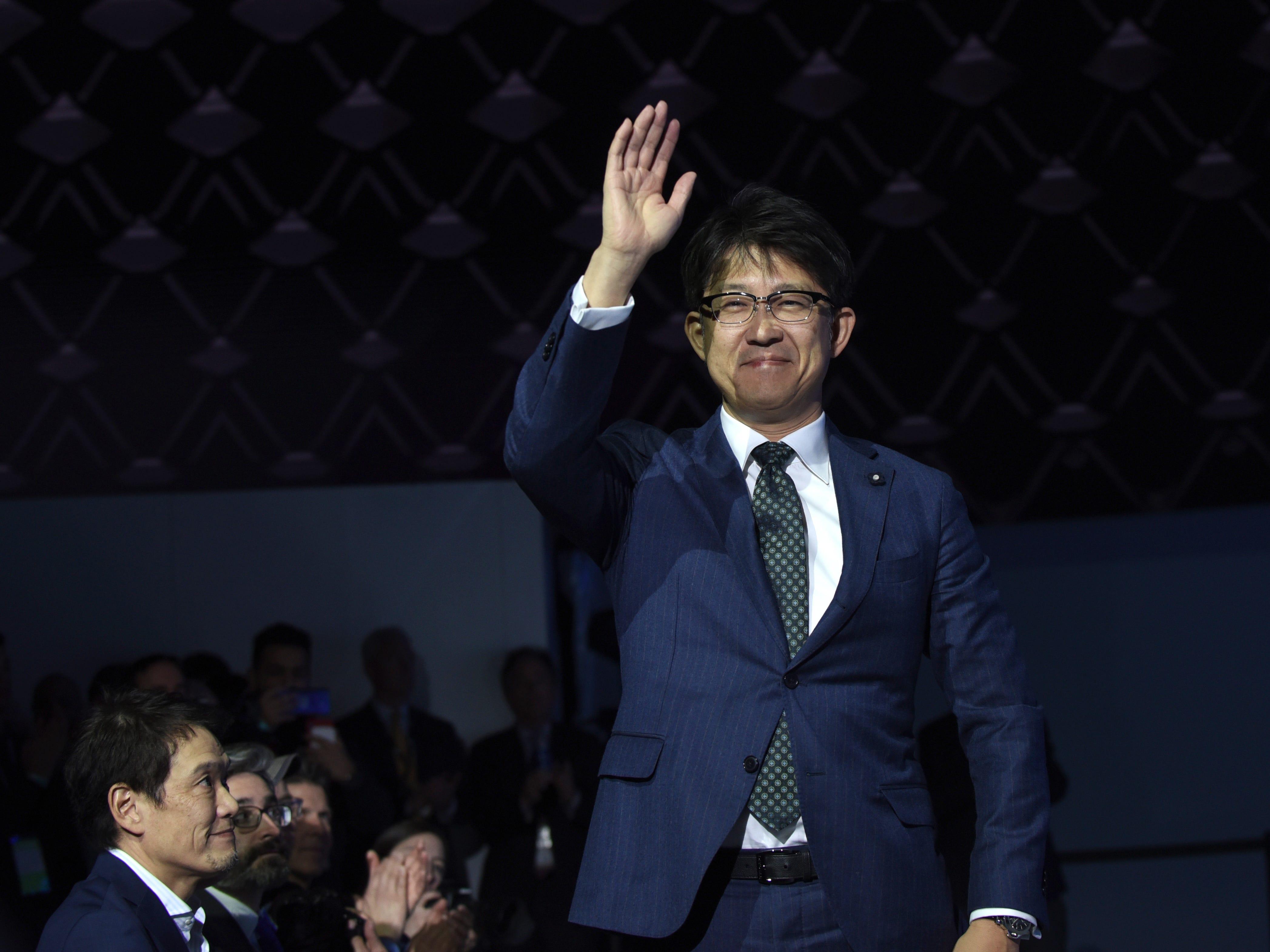 Koji Sato, executive vice president, Lexus International, waves as Lexus unveils the LC Convertible concept.