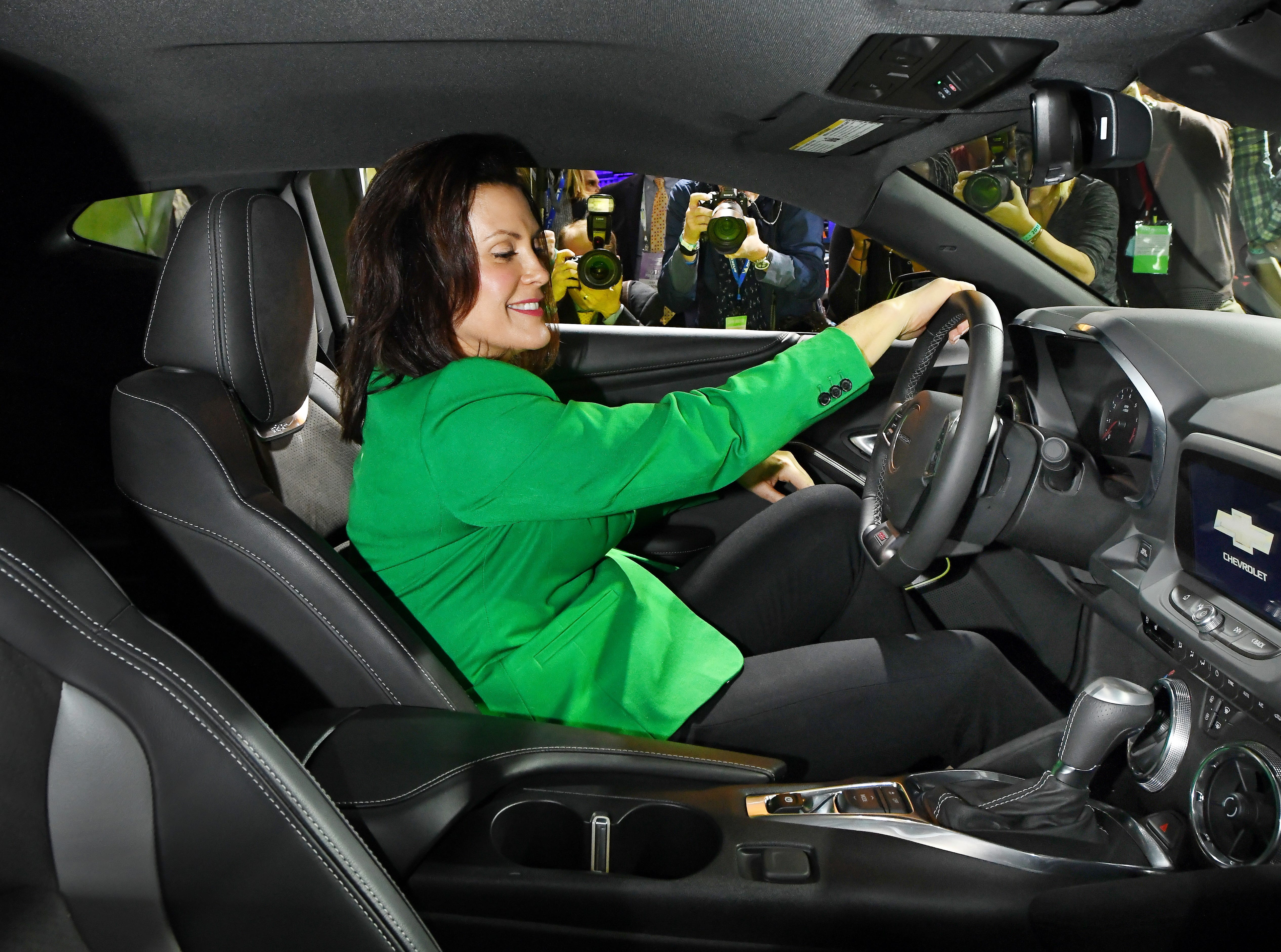 Michigan Governor Gretchen Whitmer looks pretty comfortable in a Chevrolet Camero in the General Motors display during a tour of the North American International Auto Show.