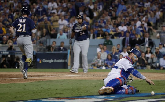 Former Dodgers catcher Yasmani Grandal has agreed to a one-year deal with the Brewers.