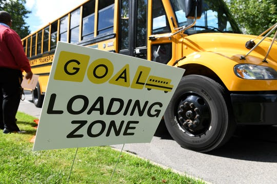 The Northwest Detroit GOAL Line Green Route school bus pulls up at University Yes Academy in Detroit.  The loop picks up participating children at the school closest to their home and transports them to the school of their choice on the line.